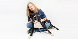 lifeline ceo rebecca guinn with a smiling dog