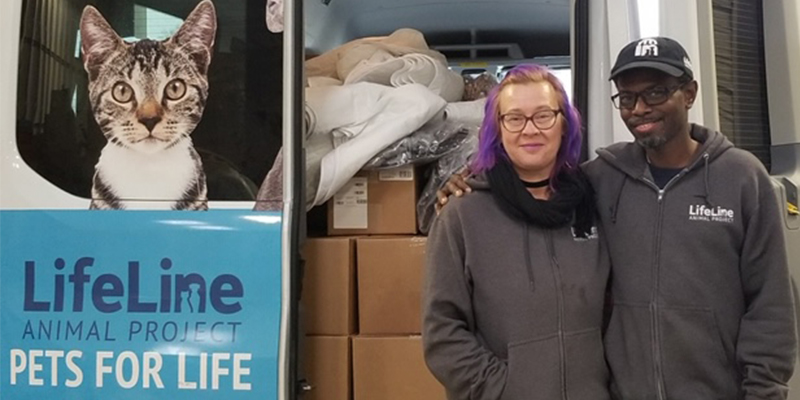 Two LIfeLine employees standing in front of Pets for Life truck.