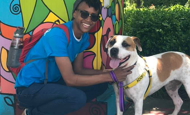 volunteer with a smiling dog